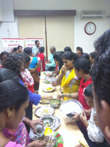 the-women-savouring-each-other-tasty-nutritional-reciepes-at-the-launch-of-the-low-cost-nutritional-cook-book